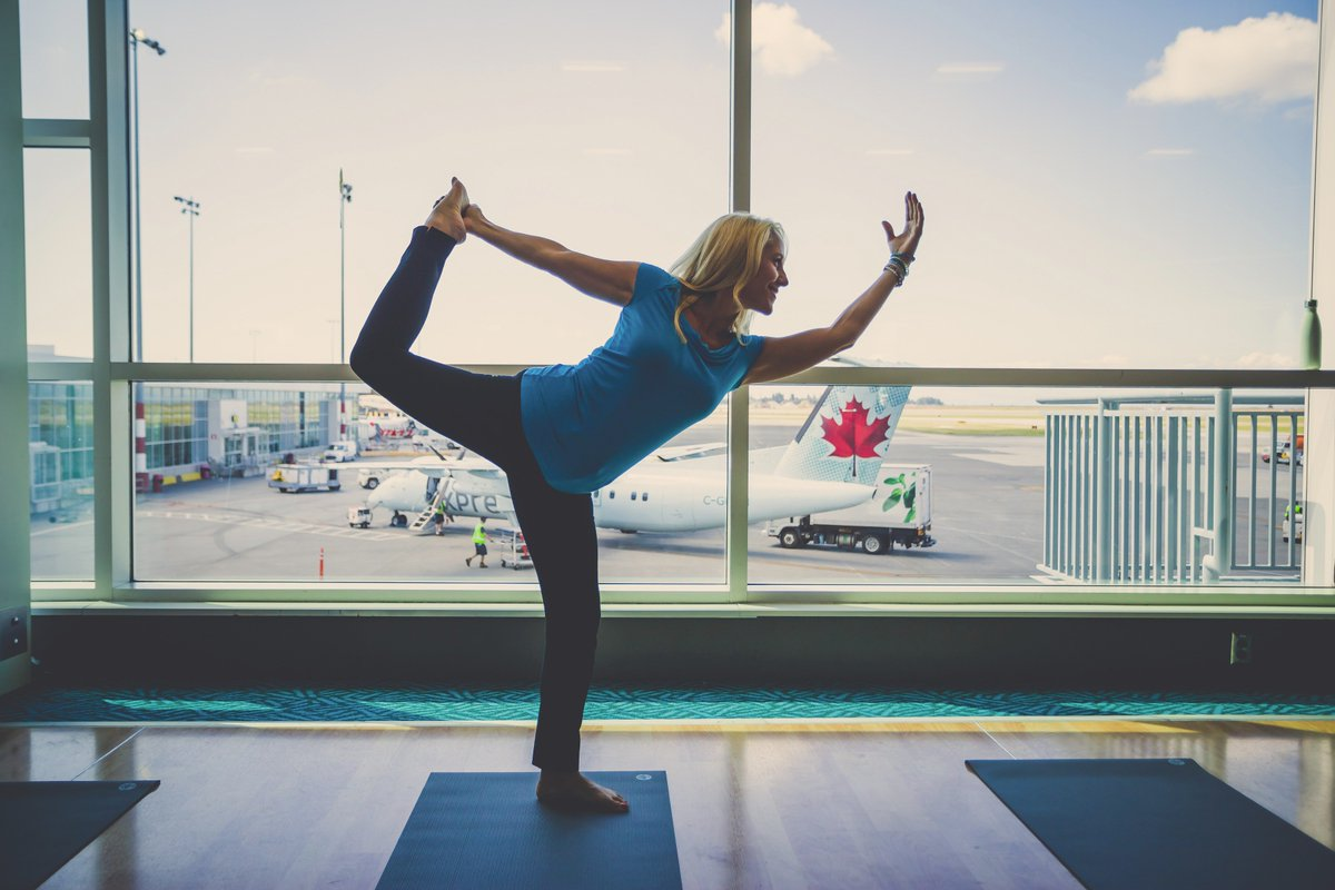 Stretch out before you take off. YVR offers free yoga post-security on YVR Take-Off Fridays: