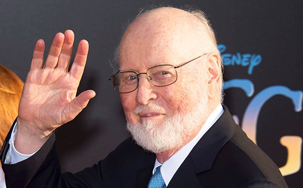 John Williams greets young musicians playing the 'Star Wars' theme outside of his house: