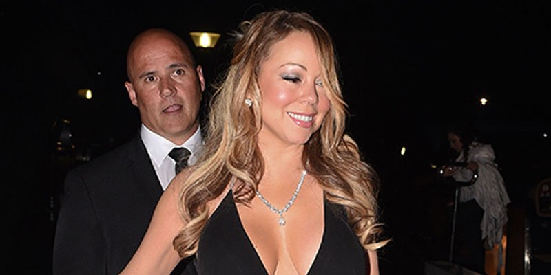 Mariah Carey wows in plunging neckline as she arrives at Leonardo DiCaprio's fundraiser