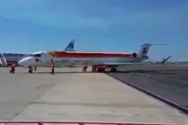 Airport staff forced to push 36-tonne plane packed with