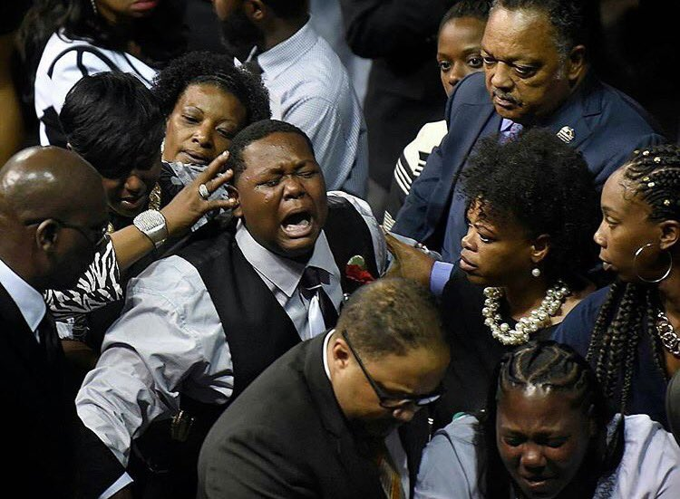 Alton Sterling's oldest child, Cameron earlier today at his fathers funeral. Pray for him.