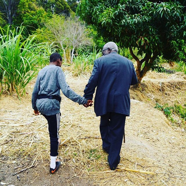 Rev. Chipeto (Agogo) walks with David before his naming ceremony. Such an unforgettable...https://t.co/saoqxZQ1gV https://t.co/9ktrGsHNz7