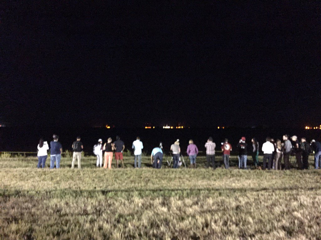 The #NASASocial group lined up and looking at the #SpaceX #Dragon all ready! #ISSCargo @NASAKennedy https://t.co/fnpYQuNpPy