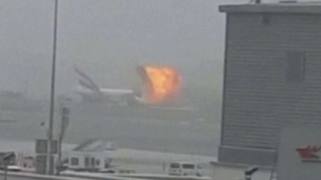 Fire guts Emirates jet after hard landing; one firefighter dies