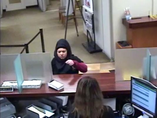 Police: Woman robs Dearborn credit union with note