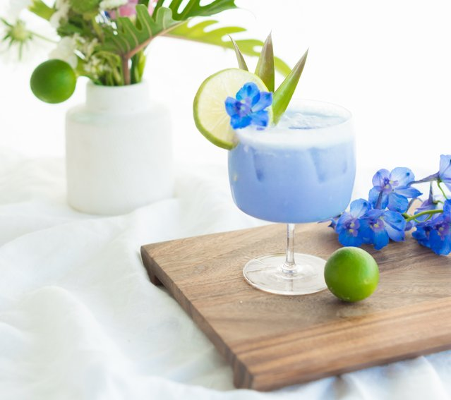 Our signature cocktail packs quite a punch - and it's blue, of course