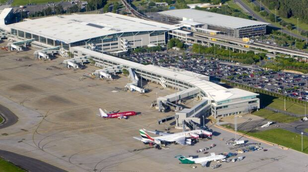 Brisbane Airport measles warning after passenger