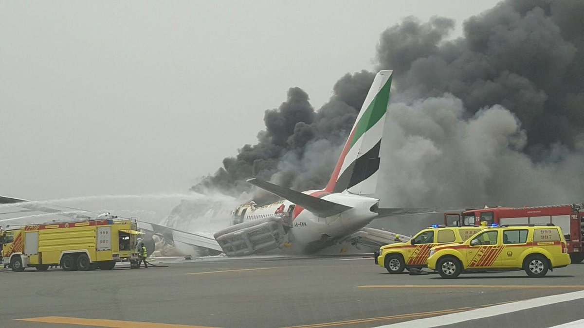 BREAKING: Exclusive Al Arabiya image shows #Emirates plane on fire at #Dubai Airport https://t.co/iKXgh8xfro https://t.co/QrcFYL0658