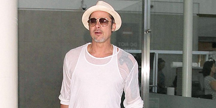 Brad Pitt wears sheer white shirt to complete his airport outfit via @People_Style