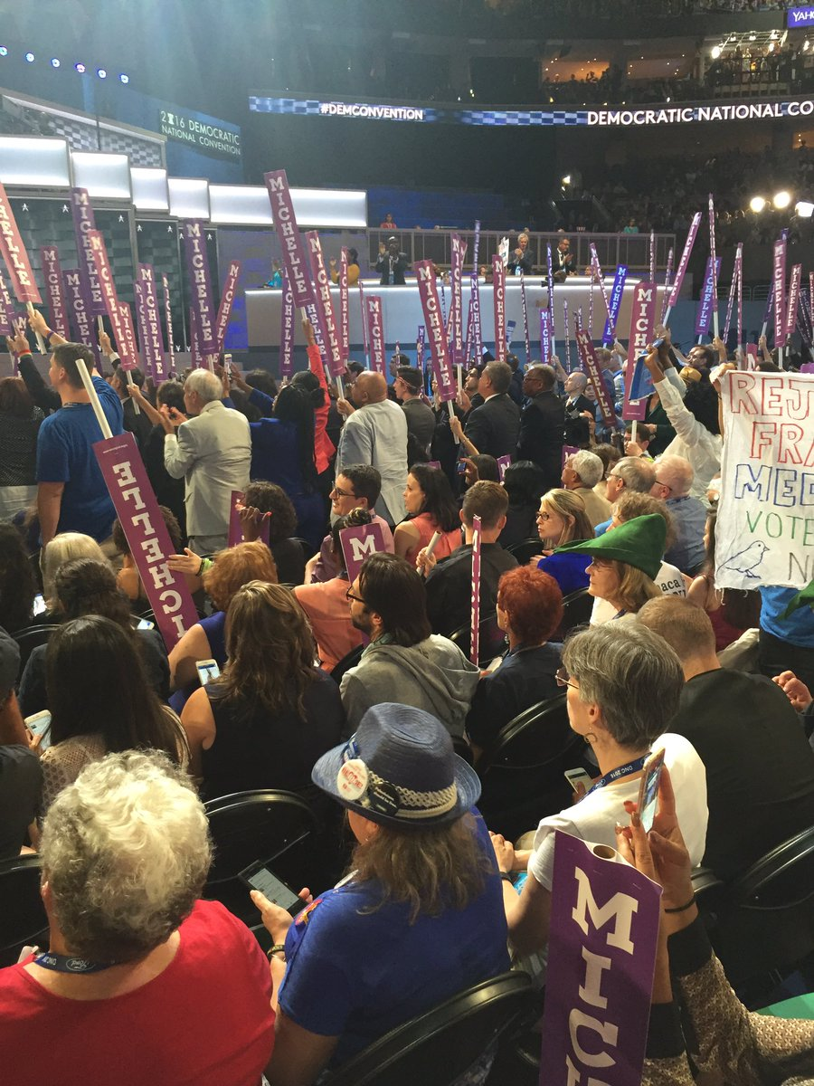 Clear divide in NY delegation between Clinton (cheering) & Sanders (sitting) supporters during @FLOTUS speech. https://t.co/eAcdAJnHH3