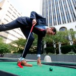 People play mini golf in front of @MandT_Bank headquarters on Main St. in #Buffalo Tuesday https://t.co/LfKOUuNKsl