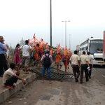 People stuck in traffic jam broke iron railings #NH8 now Kanwariyas others using it at ease #gurgaonrains @HTGurgaon https://t.co/RX6MRU2E2B
