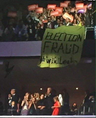 Disaffected dems 'Election Fraud #WikiLeaks' banner looms over US Vice President Jospeh Biden at the DNC #DNCLeak