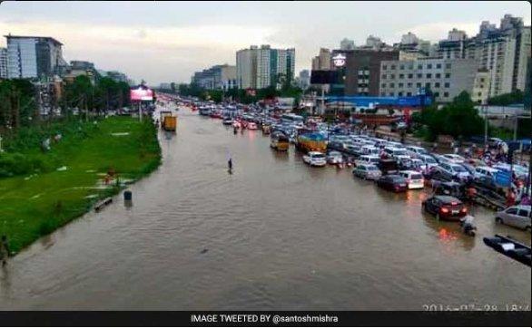 Rains cause major traffic jams in #Bengaluru #Mumbai #Gurugram. WhatsApp your pics to  ...