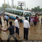 IN PICTURES | Gurgaon Drowns: Current situation at Hero Honda Chowk #HighwayToHell https://t.co/seaCIs37wI