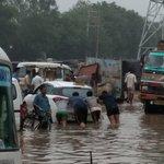 People pushing a car out of rainwater at Hero Honda chowk #NH8 #gurgaonrains @HTGurgaon https://t.co/PQP8ea82ls