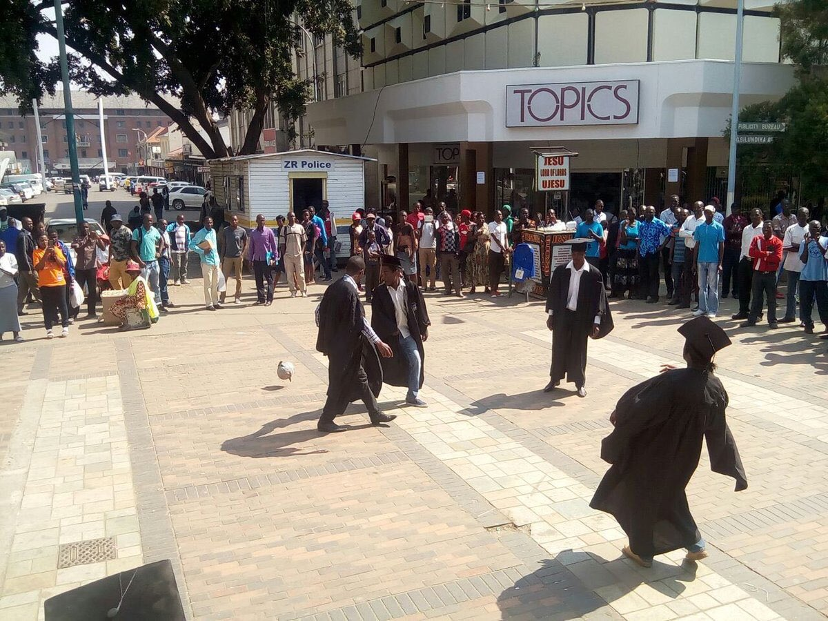 Unemployed graduates playing football in gowns in Harare. Peaceful protest under a violent regime #ThisFlag