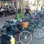 Over 30 bikes parked in corrals & adjoining sidewalk. 30 cars would stretch a full 3 blocks. @NextActPub #yegbike https://t.co/Vzm2ZFCB9M
