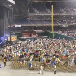 People taking their seats in pouring rain @nationals for #billyjoel @WTOP https://t.co/skvJHFg4ZC