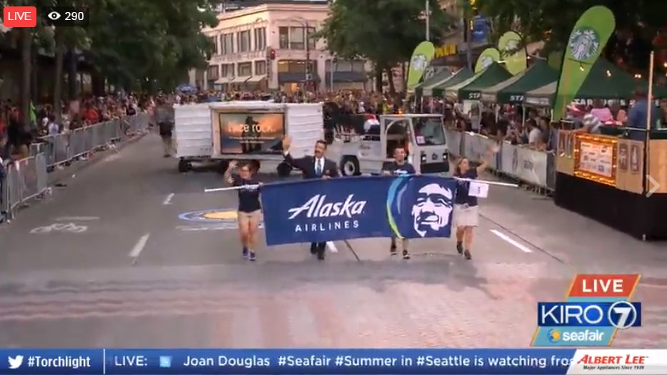 RT @KIRO7Seattle: .@AlaskaAir banner and luggage cart making its way through Torchlight.  LIVE: