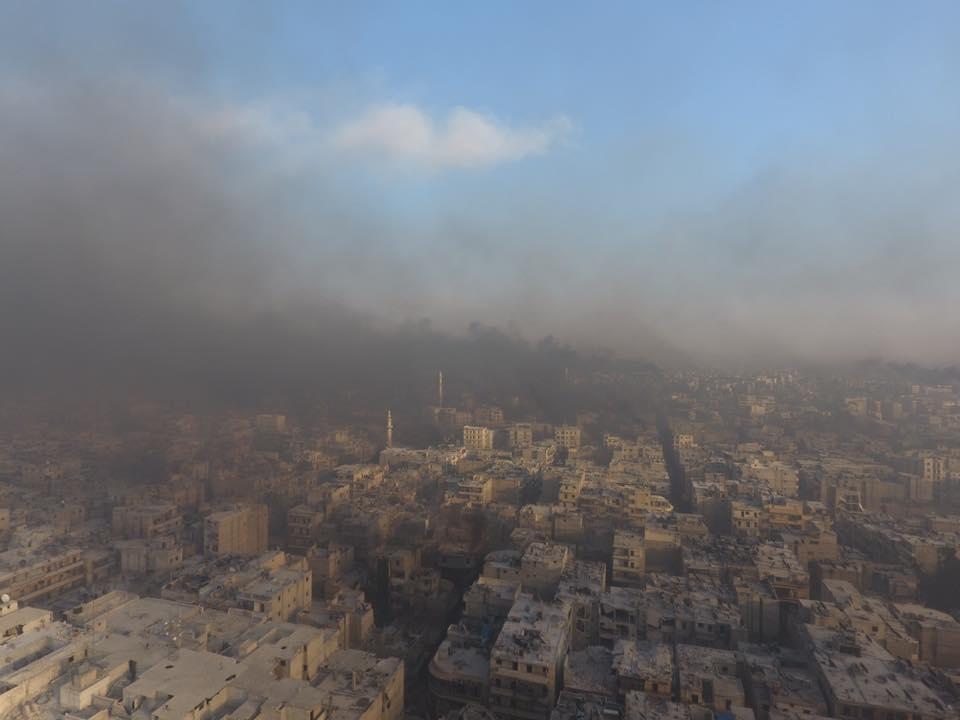 #Aleppo sky now covered n dark smoke as civilians r burning wheels 2 apply a hand made NoFlyZone V @MahmoudRashwani https://t.co/BTuA6D4UjR