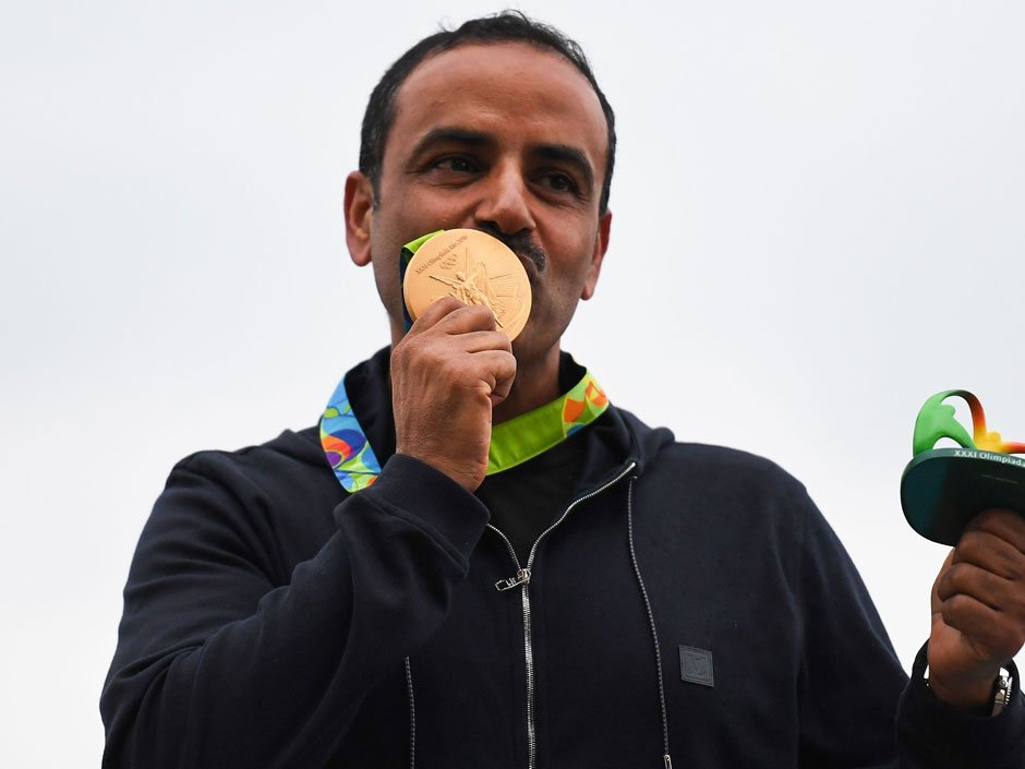 IOC banned his country, then raised its own flag, after Kuwaiti shooter wins gold