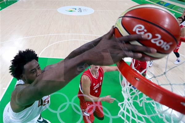 U.S. men's basketball team escapes late upset bid by Serbia