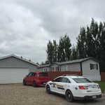 An RCMP cruiser sits here in front of the Delisle home where a couple was found dead Saturday. #Sask https://t.co/hn8WpI4Acq