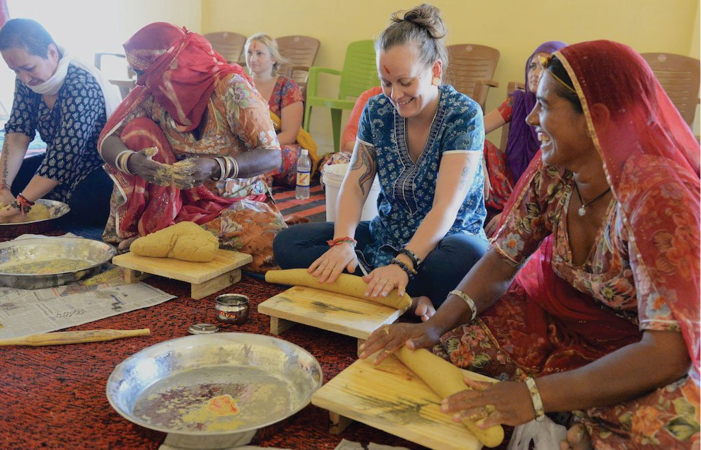 """#Food is our common ground, a universal experience."" -J. Beard-@WholeFoods Volunteers make papadum in #India, 2014. https://t.co/I0JwZ1gTX7"