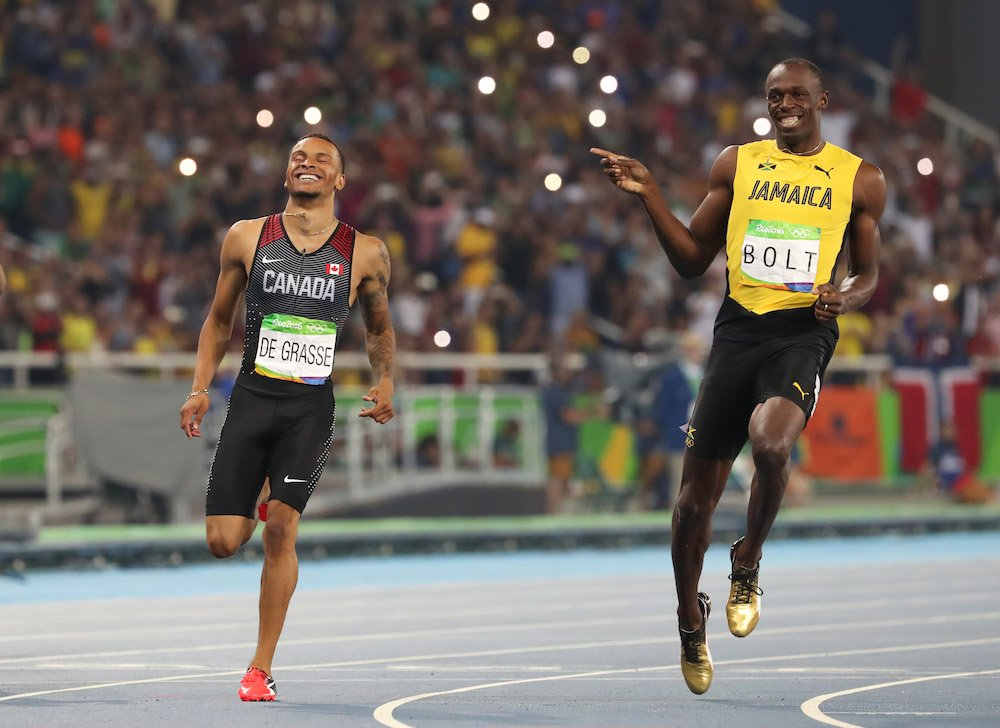 That magic moment when @De6rasse pushes Usain Bolt to the line in the 200 metres. Photo by Jean Levac/Postmedia https://t.co/So7ikDDJAN