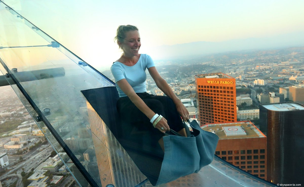 Would you slide down a glass slide attached to a skyscraper? 😱  Come to LosAngeles!