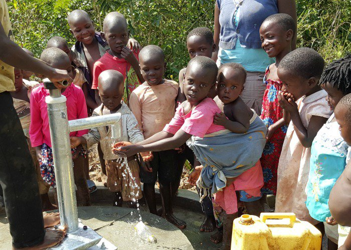Happy #WorldHumanitarianDay ! These children in Uganda are enjoying clean water from their new well!
