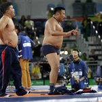 Mongolia's wrestling coaches strip off their clothes in epic meltdown following bronze medal match