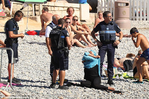 #BurkiniBan continues its empowerment of women- in this case 4 armed, white men standing over woman making her strip https://t.co/8TnYb0yWMy