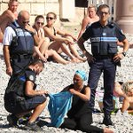 Height of absurdity: Nice police seem to force burkini-clad woman to remove it and fine her. https://t.co/rhHfOEQ5Dz https://t.co/yQ4egCwjrq