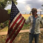This gentleman may have lost his roof in the storm near Enid earlier this evening, but hes got his flag. @koconews https://t.co/ZriAehBGWa