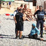 French police make woman remove clothing on Nice beach following burkini ban. PJ is getting the low down. #wearecork https://t.co/vRqkkCZgLk