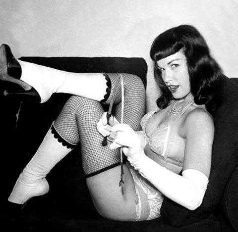 Somebody's been naughty! Which one of you is gonna get it?  #BettiePage #domme #fetish #whipit #pinup
