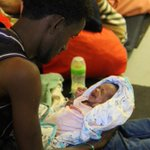 One of the rescued, a single father, holds his 1 week old baby; his wife recently passed away. #MSFsea #Dignity1 https://t.co/e55A0dlqF1