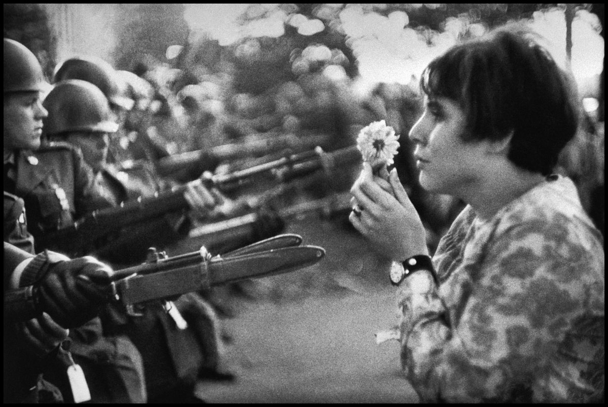 Marc Riboud has died at age 93. He took this photograph at a Vietnam demonstration in DC '67. Obit published soon. https://t.co/7rylLQiW1L
