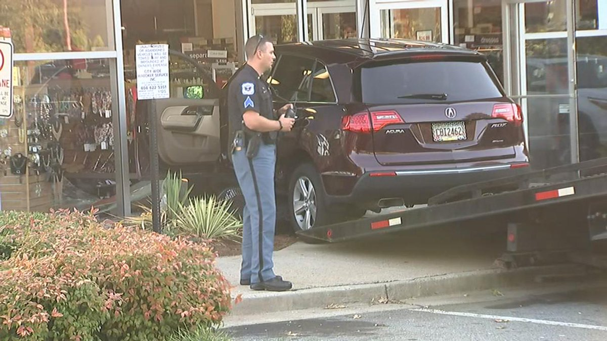#BREAKING: Car drives into K&G Superstore on Busbee Parkway in Cobb County --