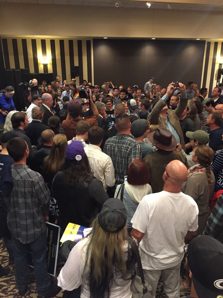 .@GovGaryJohnson mobbed by activists after #JohnsonWeld2016 rally in Seattle #LetGaryDebate https://t.co/CkRKF8haH7