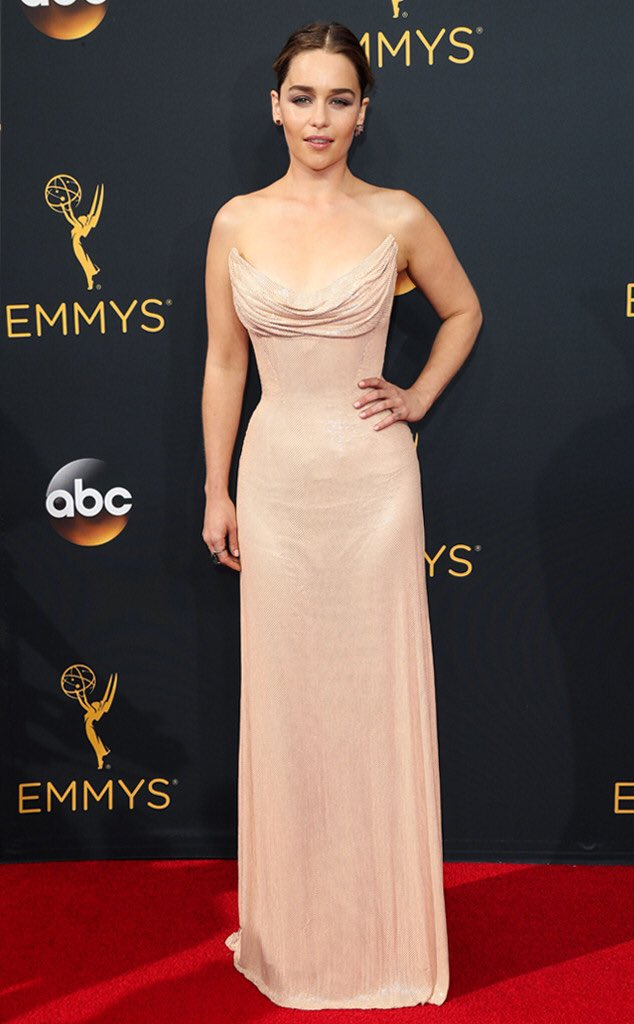 Going for a more sleek look, @EmiliaClarkeTM stuns in this shimmering @Versace gown. We love the bodice! #Emmys https://t.co/E5p64QLxgM