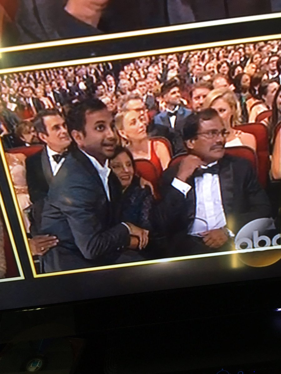 Aziz with his parents, sitting on his mom's lap, is everything!