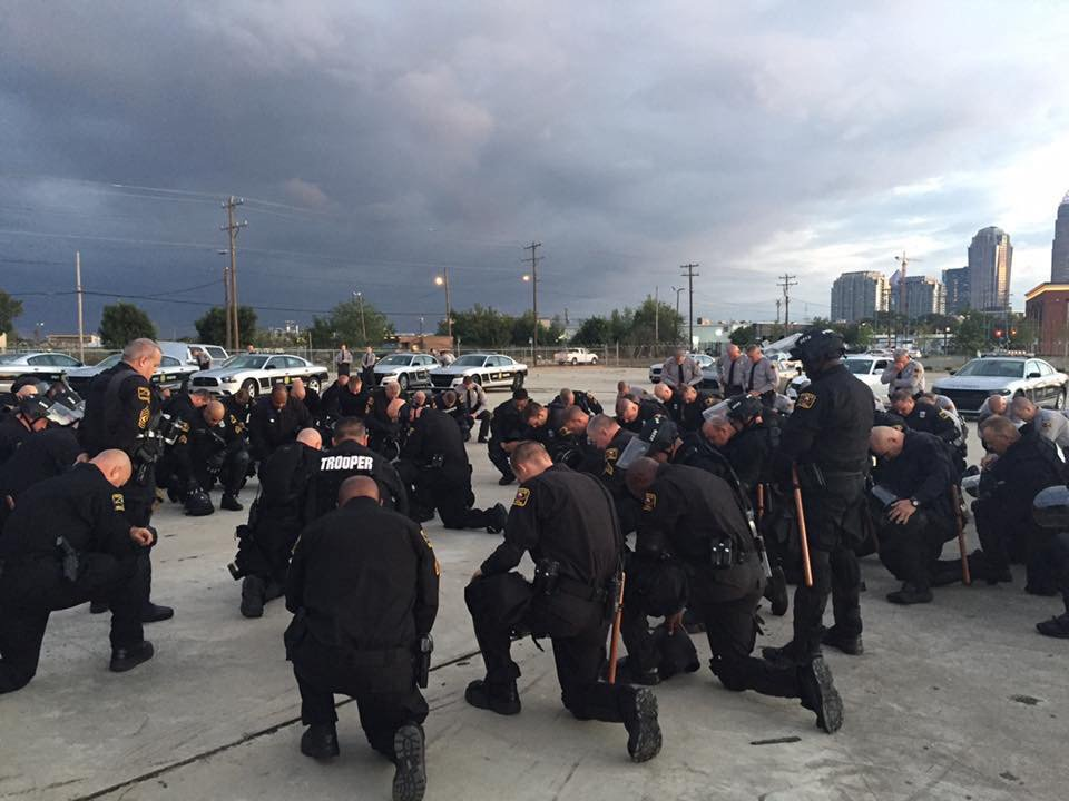 Powerful.   Photo of @NCSHP troopers praying before being deployed on streets of #CLT tonight. @WBTV_News https://t.co/vaHYgqqo6t