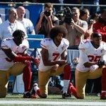 Photo of Eli Harold joining Colin Kaepernick in protest https://t.co/k73109z0LW https://t.co/wP6w7HpS0X