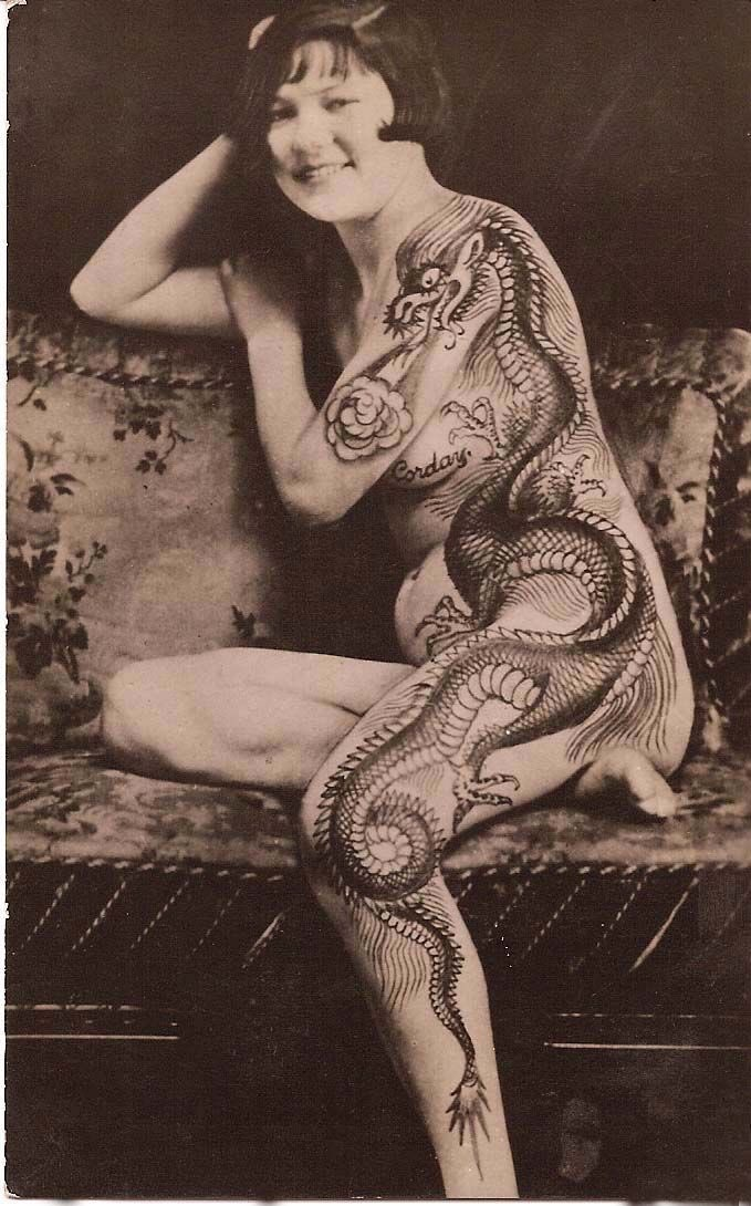 @Siniful  RT @WhoresofYore: Girl with the original dragon tattoo.   C.1920s  (Artist, model unknown - sadly) https://t.co/KZDSefu8Ej