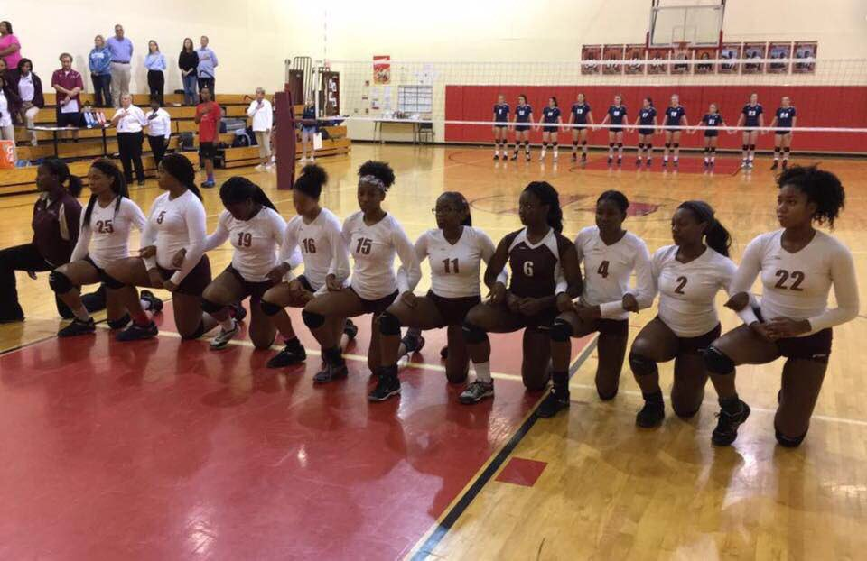Girls Volleyball Team from Tindley Accelerated School. Indianapolis,  Indiana. Taking a knee for