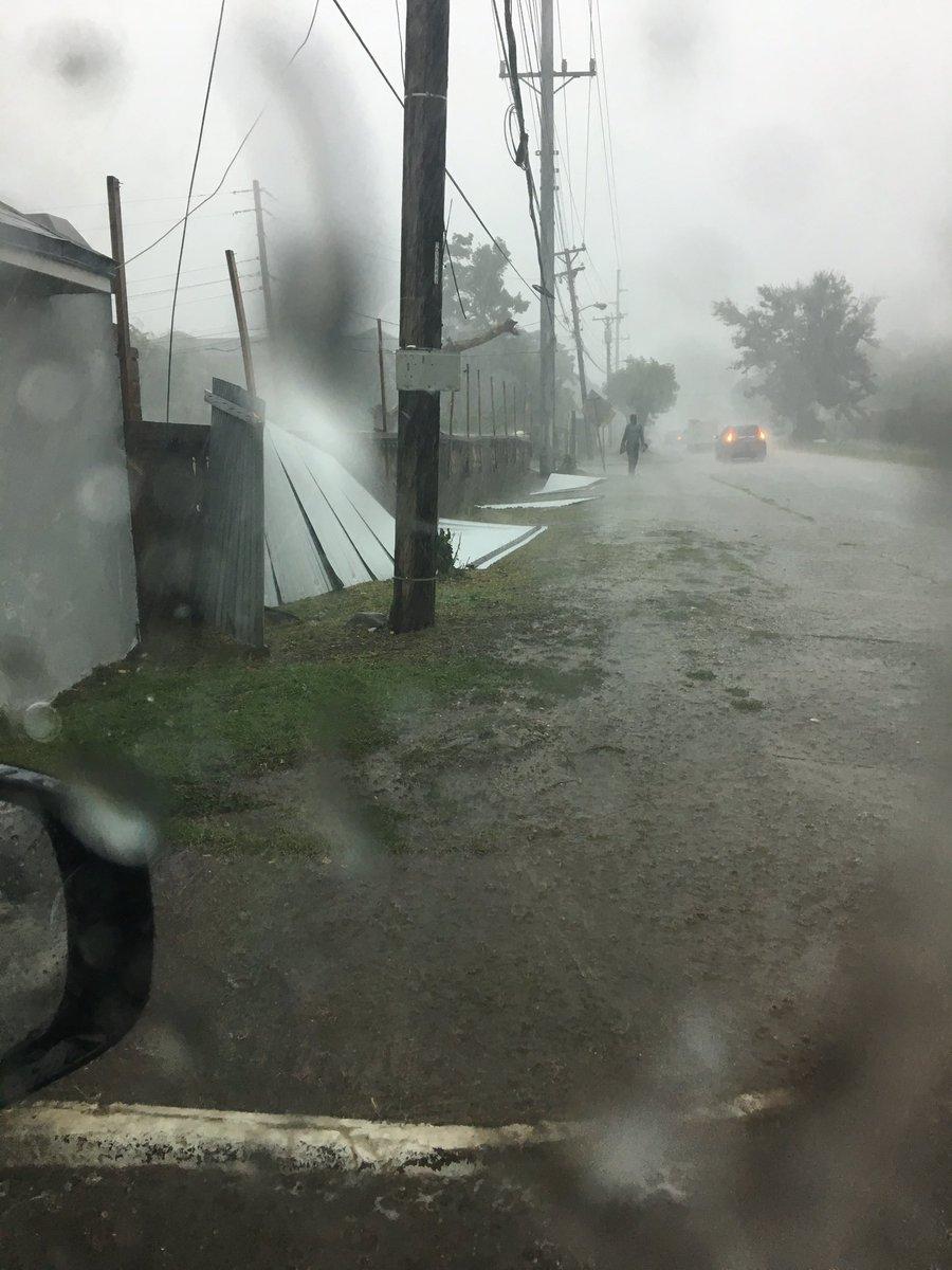 Zinc fence already down since rain started. Earlier road traffic lights taken down. #HurricaneMatthew #Jamaica https://t.co/M7feG0ZeK8