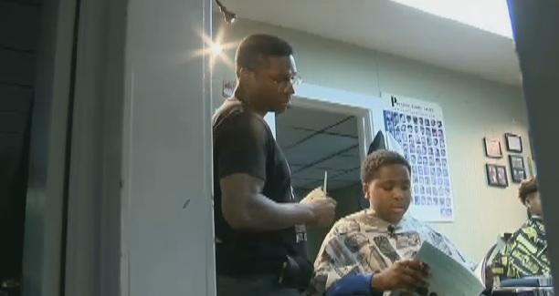 Young students get discount for reading in barber shop -